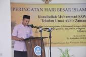 Ketua Panitia Maulid Nabi Muhammad SAW 1438 H Badan Bahasa, Hidayat Widiyanto sedang membacakan laporannya